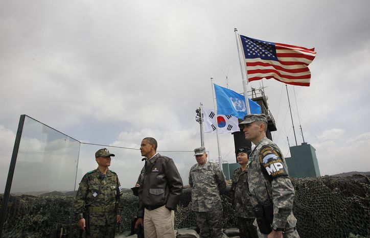President Obama (second from left) meets March 25, 2012, with members of the South Korean and U.S. militaries at Observation Post Ouellette in the Demilitarized Zone (DMZ), the tense military border bet