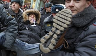 Russian police detain a protester during an unsanctioned rally against Prime Minister Valdimir Putin, the president-elect, in Moscow on Sunday, April 1, 2012. (AP Photo/Mikhail Metzel)