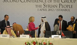 U.S. Secretary of State Hillary Rodham Clinton speaks with an Arab official as she arrives to join foreign ministers from dozens of countries gathered in Istanbul on Sunday, April 1, 2012, to set conditions for a new Syria. (AP Photo)