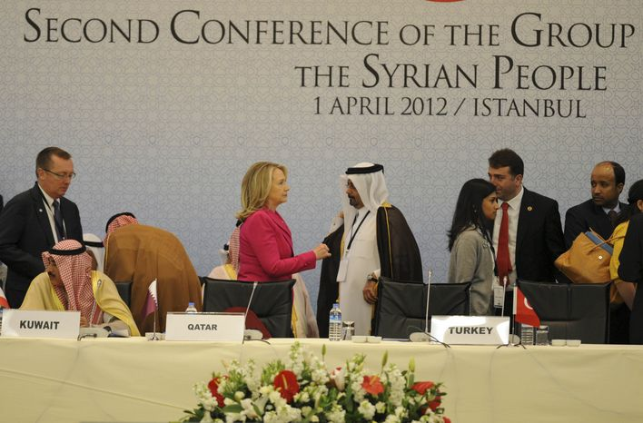 U.S. Secretary of State Hillary Rodham Clinton speaks with an Arab official as she arrives to join foreign ministers from dozens of countries gathered in Istanbul on Sunday, April 1, 2012, to set condi