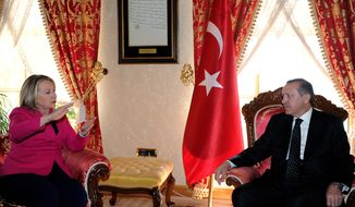 Turkish Prime Minister Recep Tayyip Erdogan (right) speaks with U.S. Secretary of State Hillary Rodham Clinton in Istanbul on Sunday, April 1, 2012. (AP Photo/Yasin Bulbul, Turkish Prime Minister's Press Service)