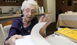 Verla Morris, 99, goes through some of her family census data from the 19th and 20th centuries at her local residential senior center on March 30, 2012, in Chandler, Ariz. (Associated Press)