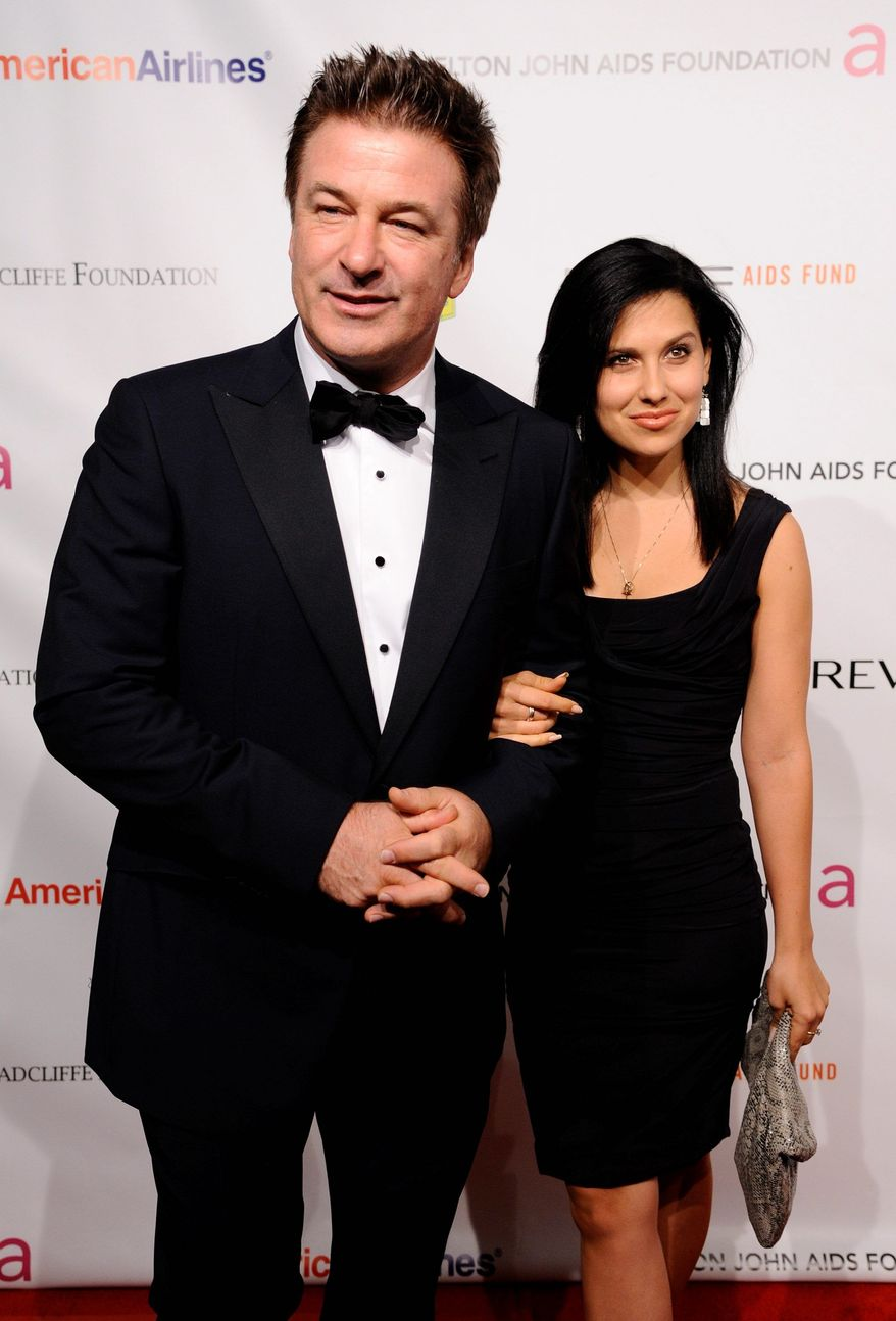 FILE - In this Oct. 26, 2011 file photo, actor Alec Baldwin, left, and Hilaria Thomas attend the Elton John AIDS Foundation 10th Annual Enduring Vision Benefit in New York. Baldwin proposed to Thomas over the weekend. They began dating last year. Baldwin was married once before to actress Kim Basinger.( (AP Photo/Peter Kramer, file)