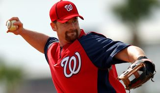 Infielder Chad Tracy was among those who got to bask in the news that they made the Nationals' 25-man roster. (Associated Press)