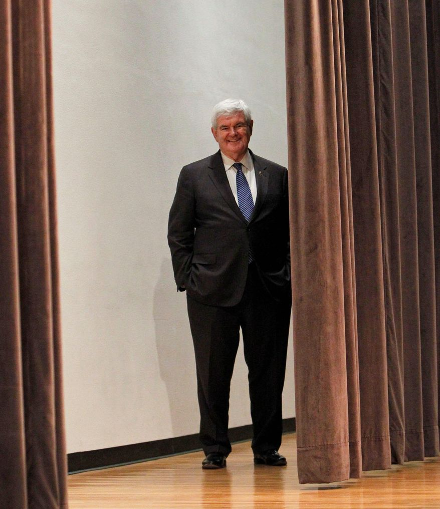 "Former House Speaker Newt Gingrich prepares to speak to the Hood College Republicans during a campaign stop at Hood College in Frederick, Md., on Monday. ""Gov. Romney doesn't have it locked down. And we have no obligation to back off and concede anything until he does,"" he said. (Associated Press)"
