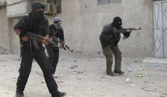 Free Syrian Army fighters train April 1, 2012, in a neighborhood of Damascus, Syria. (Associated Press)