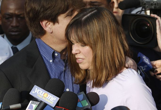 Former Illinois Gov. Rod Blagojevich kisses his wife, Patti, while speaking to the media March 14, 2012 in Chicago. (Associated Press)