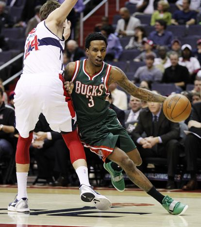 Milwaukee Bucks point guard Brandon Jennings drives past Washington Wizards forward Jan Vesely during the first half of an NBA basketball game on Monday, April 2, 2012, in Washington. Jennings contributed 19 points as the Bucks won 112-98. (AP Photo/Evan Vucci)