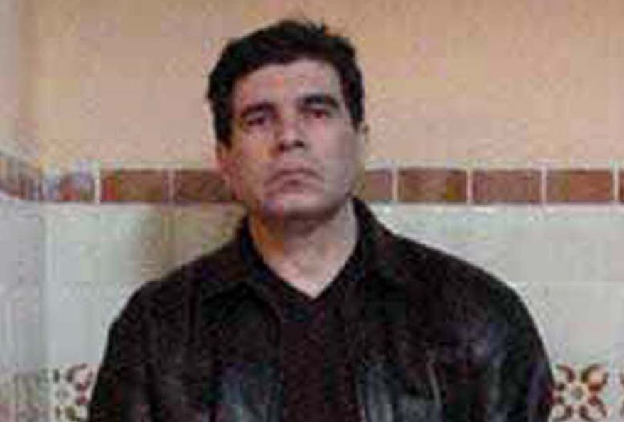** FILE ** Drug trafficker Benjamin Arellano Felix is shown on the day of his arrest in March 2002 at his house in Puebla, Mexico. (AP Photo)
