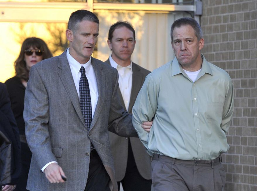 ** FILE ** JetBlue Airways Capt. Clayton Osbon (right) is escorted to a waiting vehicle by FBI agents as he is released from the Pavilion at Northwest Texas Hospital in Amarillo, Texas, on Monday, April 2, 2012. (AP Photo/Amarillo Globe-News, Michael Schumacher)