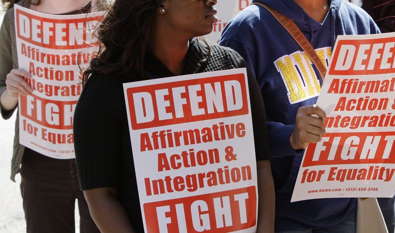 **FILE** Students demonstrate outside the Federal Courthouse on March 7, 2012, in Cincinnati, where the Sixth Circuit Court of Appeals was hearing oral arguments in their review of their 2011 ruling that Proposal 2, the ban on affirmative action in Michigan, is unconstitutional. (Associated Press)
