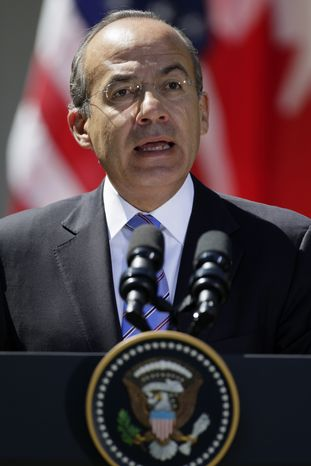 Mexican President Felipe Calderon speaks April 2, 2102, during a joint news conference with President Obama and Canadian Prime Minister Stephen Harper in the Rose Garden of the White House. (Associated Press)