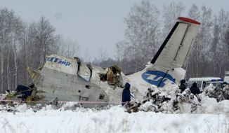 Russian Emergency Ministry rescuers search the site where an ATR-72 turboprop plane crashed outside the Siberian city of Tyumen, Russia, on Monday, April 2, 2012. (AP Photo/Marat Gubaydullin)