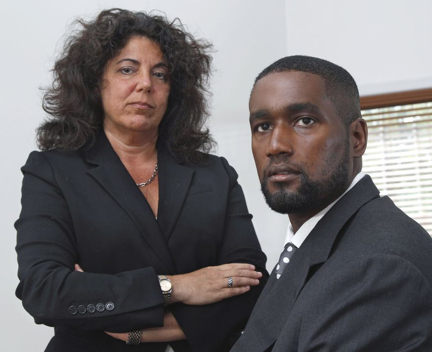 **FILE** Albert Florence (right) sits Oct. 11, 2011, at his home in Bordentown, N.J., with his attorney Susan Chana Lask. Florence faced strip searches in two county jails following his arrest on a warrant for an unpaid fine that he had, in reality, paid. (Associated Press)