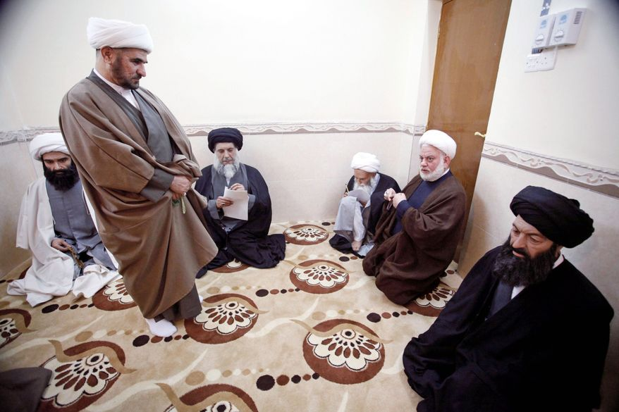 Two men (above left and second from right) examine likenesses of Shiite clerics (top) at the wax museum in the Shiite holy city of Najaf, 100 miles south of Baghdad. Even before going on public display, the wax figures have created an Islamic law dispute. All of the Shiite figures were either born, studied or buried in Najaf. (Associated Press)