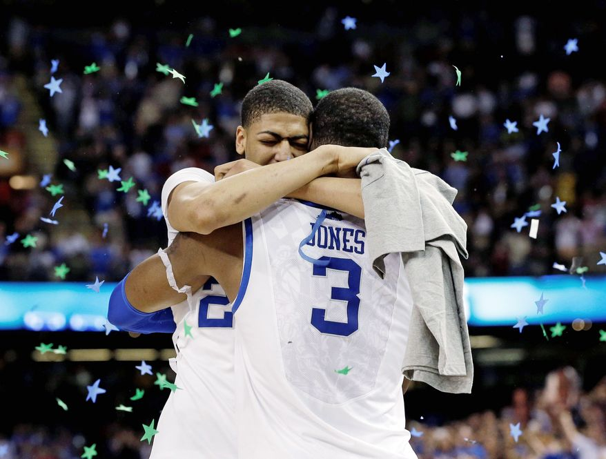 Forwards Terrence Jones and Anthony Davis share a victory hug after Kentucky claimed its eighth national title. Davis is expected to declare for the NBA draft, where he likely would be the No. 1 pick.s