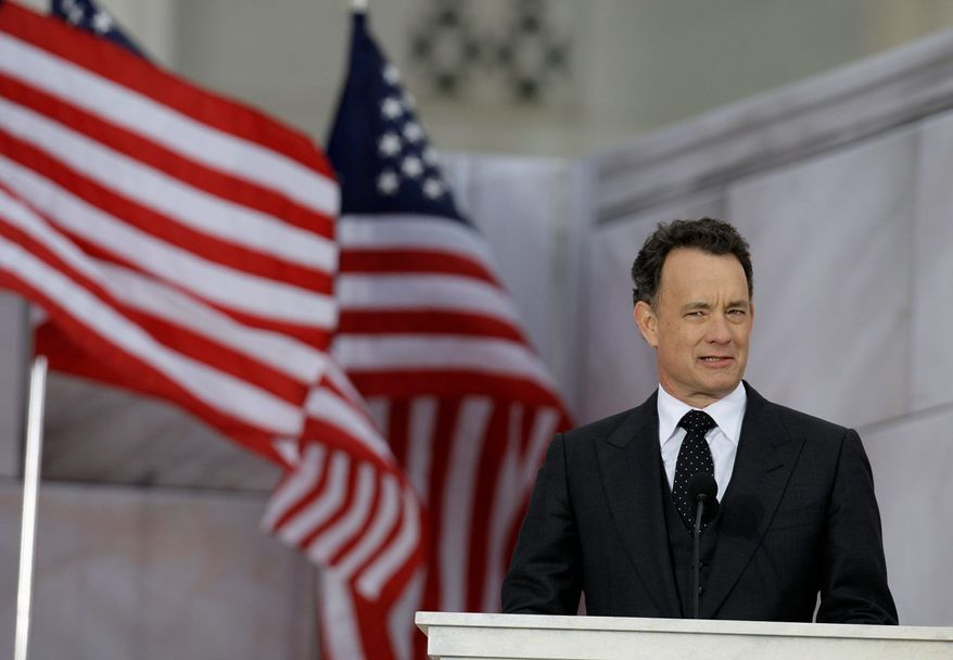 Actor Tom Hanks, seen here on Jan. 18, 2009, addressing a pre-inaugural gathering at the Lincoln Memorial in Washington two days before the inauguration of President Obama, recently narrated Mr. Obama's long-form 2012 re-election campaign ad. (Associated Press)