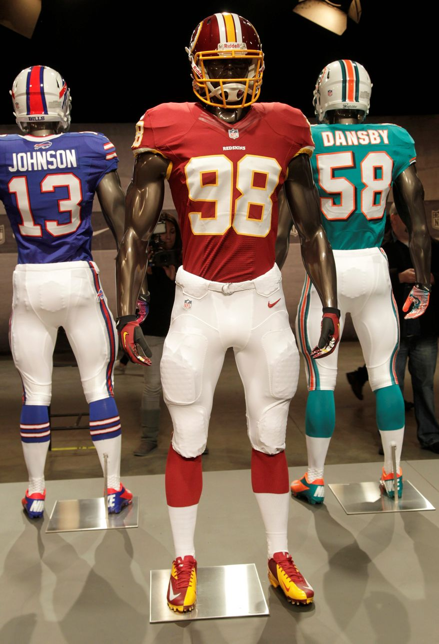 The new Washington Redskins uniform, designed by Nike, is displayed in New York. Some teams have opted to maintain a traditional look, and others are seeking to be more cutting edge. (Associated Press)
