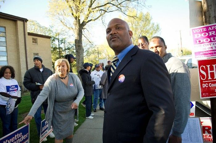 Ward 7 D.C. Council member Yvette M. Alexander and challenger Tom Brown chat with voters arriving at St. Timothy's polling station, in Southeast Washington. (Rod Lamkey Jr./The Washington Times)