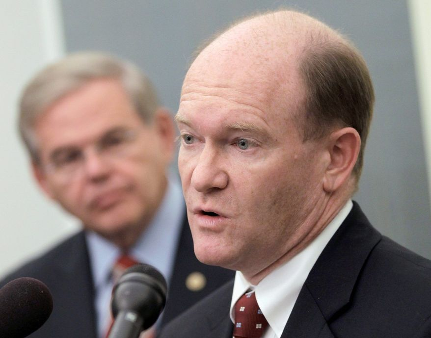 Rep. Chris Coons, Delaware Democrat, accompanied by Sen. Robert Menendez, New Jersey democrat, talks about the Palestinian effort to seek U.N. recognition of statehood, Tuesday, Sept. 20, 2011, during a news conference on Capitol Hill in Washington. (AP Photo/J. Scott Applewhite)