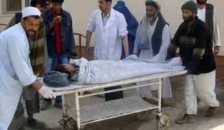 Afghans transport a boy injured in a bomb blast to a hospital in New Baghlan, Afghanistan, north of Kabul, on Monday, April 2, 2012. The governor in the northern Baghlan province said twin bomb blasts in the city wounded several people, including eight police officers. (AP Photo/Javid Basharat)
