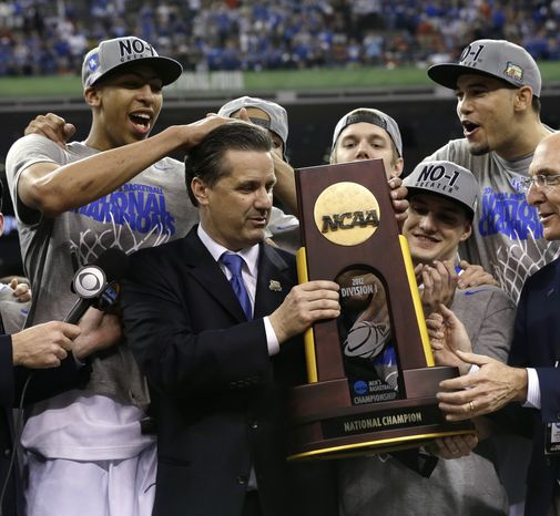 Kentucky head coach John Calipari, center, celebrates with his team after it won the NCAA championship game against Kansas on Monday, April 2, 2012, in New Orleans. Kentucky won 67-59. (AP Photo/David J. Phillip)