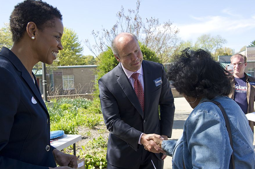 John Delaney (center), a Democratic candidate for Congress in Maryland, shakes hands with a voter outside of Flower Valley Elementary School in Rockville, Md., as Rep. Donna F. Edwards (left) watches on April 3, 2012, the day of Maryland's primary election. Delaney has been in a tight race with state Senate Majority Leader Robert J. Garagiola. (Barbara L. Salisbury/The Washington Times)