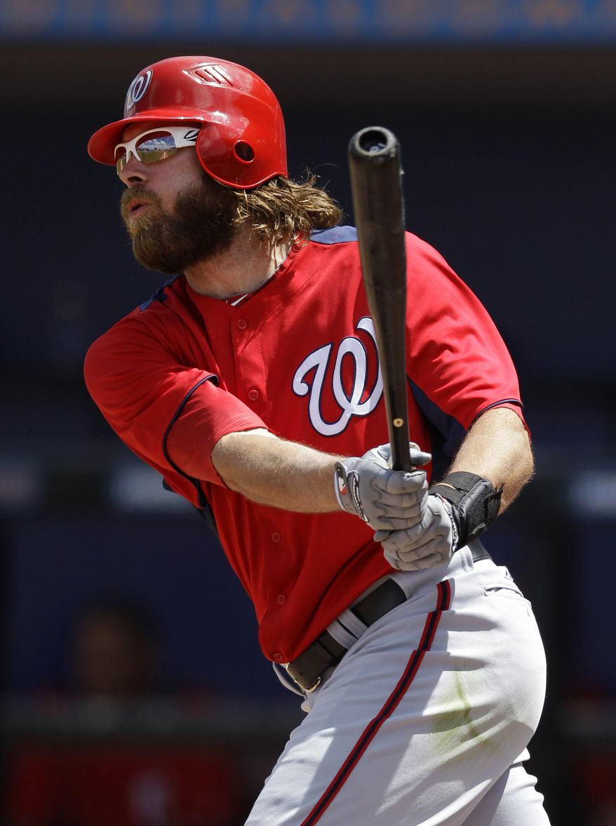 Washington Nationals' Jayson Werth hits a solo home run in the fourth inning of a spring training game against the New York Mets in Port St. Lucie, Fla., Wednesday, March 28, 2012. (AP Photo/Patrick Semansky)