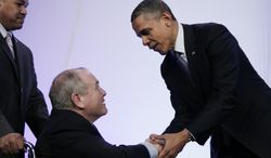 President Obama shakes hands April 3, 2012, with Dean Singleton, the outgoing AP chairman of the board, after Singleton introduced him to speak at the Associated Press luncheon during the ASNE Convention in Washington. (Associated Press)