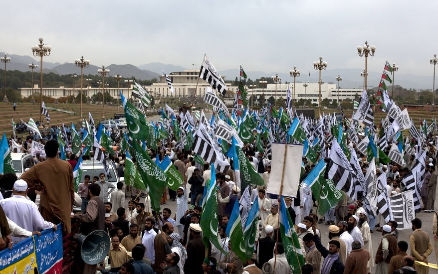 **FILE** Supporters of Pakistani religious parties rally March 27, 2012, near the Parliament in Islamabad, Pakistan, against the Pakistani government allowing NATO to resume shipping supplies through the country to its troops in neighboring Afghanistan. (Associated Press)