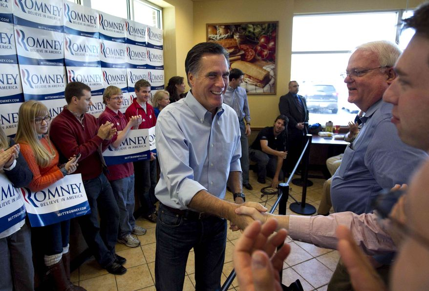 Republican presidential candidate, former Massachusetts Gov. Mitt Romney greets people during a campaign stop at a Cousins Subs fast food restaurant, in Waukesha, Wis., Tuesday, April 3, 2012. (AP Photo/Steven Senne)