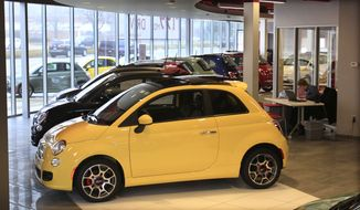 Fiat 500 vehicles are on show at the Golling Fiat dealership in Birmingham, Mich., on Wednesday, Feb. 29, 2012. (AP Photo/Carlos Osorio)