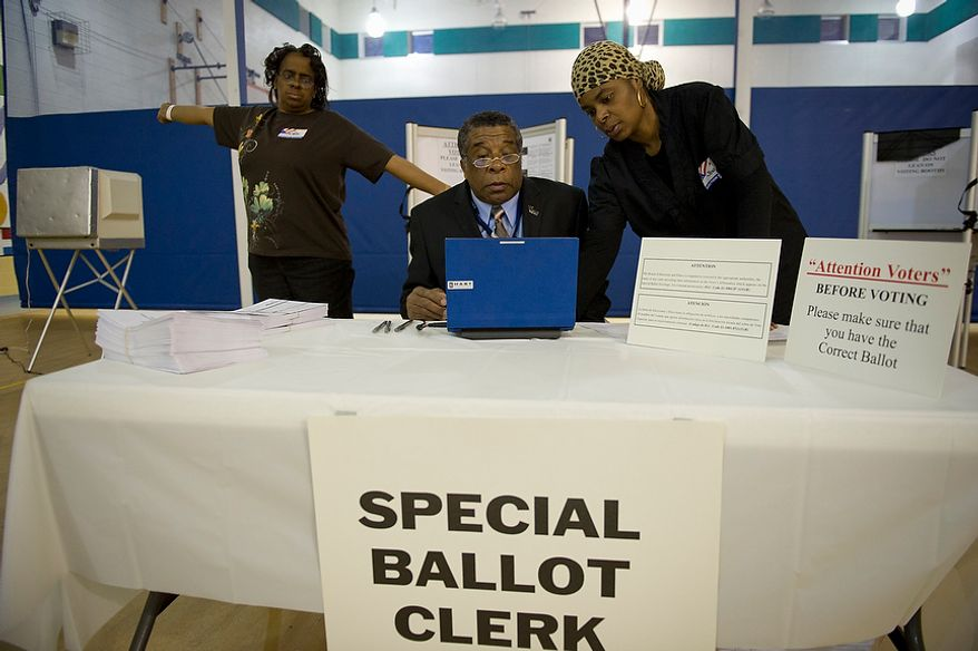 In the pre-dawn hours, election officials (from left) Denise McNeal, Charles Hudson and Quanic Jenkins prepare voting equipment at the Randle Highlands Elementary School in Washington as the nation's capital holds its primary election on Tuesday, April 3, 2012. (Rod Lamkey Jr./The Washington Times)