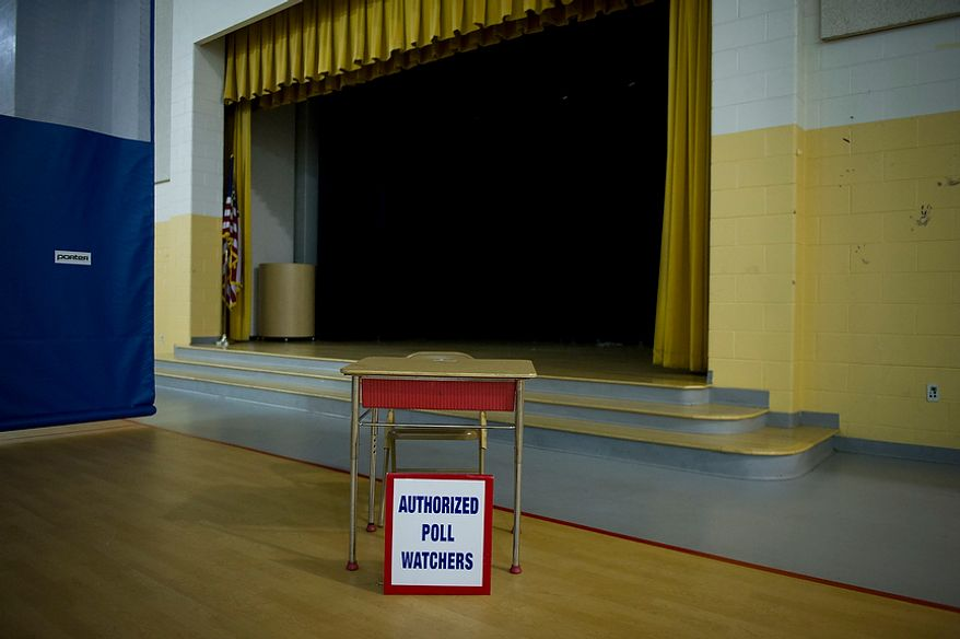 "A desk serving as the ""authorized poll watchers"" station sits empty in the pre-dawn hours at Randle Highlands Elementary School precinct in Washington as the nation's capital holds its primary election on Tuesday, April 3, 2012. (Rod Lamkey Jr./The Washington Times)"