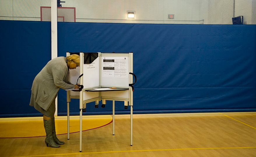 D.C. Council member Yvette Alexander, Ward 7 Democrat, casts her ballot at the Randle Highlands Elementary School in Washington as the nation's capital holds its primary election on Tuesday, April 3, 2012. (Rod Lamkey Jr./The Washington Times)