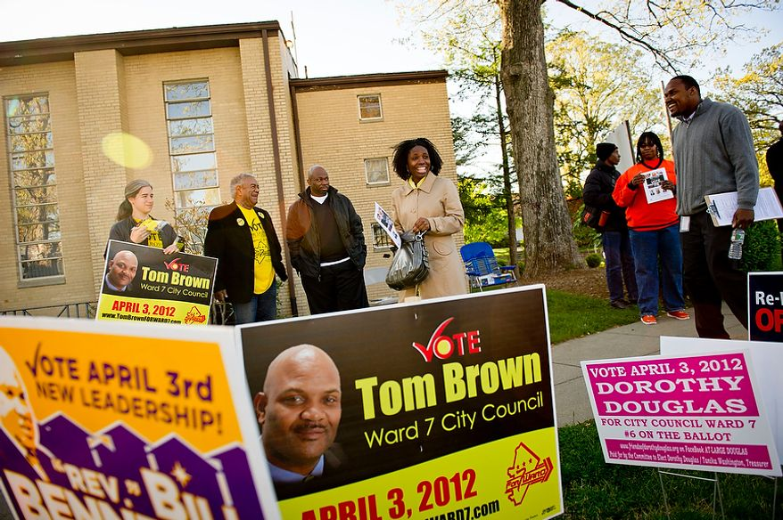 A voter passes a gantlet of campaign supporters as she makes her way to her voting precinct at St. Timothy's Episcopal Church in Washington as the nation's capital holds its primary election on Tuesday, April 3, 2012. (Rod Lamkey Jr./The Washington Times)