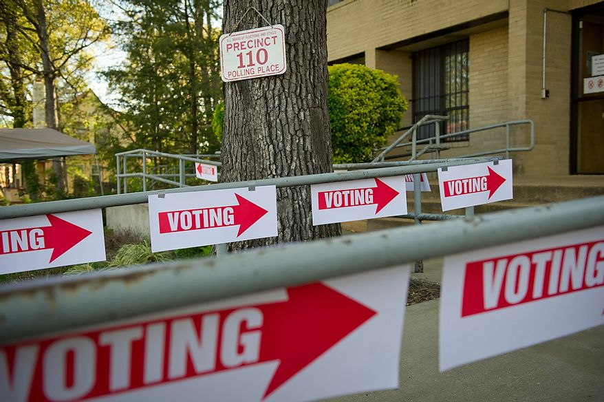 Voting signs cover the handrails at St. Timothy's Episcopal Church in Washington as the nation's capital holds its primary election on Tuesday, April 3, 2012. (Rod Lamkey Jr./The Washington Times) ** FILE **