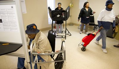Assistant poll captain Glinder Barnes (second from right) watches as Mattie B. Butts (left), Marion Ross (second from left) and Teresa Stuart (right) turn out to cast their vote at Precinct 116 inside the New Image Baptist Church on Alabama Avenue Southeast in Washington on Tuesday, April 3, 2012. (Andrew Harnik/The Washington Times)