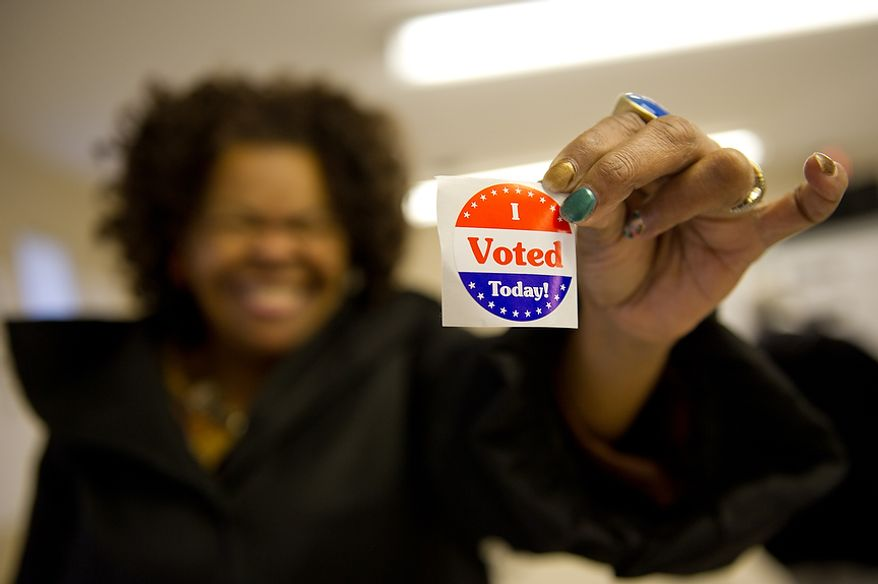 Joyce Reed of Ward 8 casts her vote at Precinct 116 inside the New Image Baptist Church on Alabama Avenue Southeast in Washington on Tuesday, April 3, 2012. (Andrew Harnik/The Washington Times)
