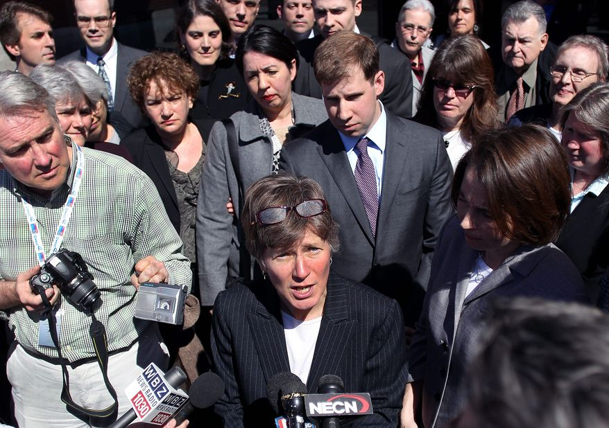 Mary Bonauto, an attorney for GLAD, addresses reporters Wednesday after a hearing at the 1st U.S. Circuit Court of Appeals in Boston. Lawyers for the gay group contend that a federal law that denies benefits to married gay couples is discriminatory. (Associated Press)