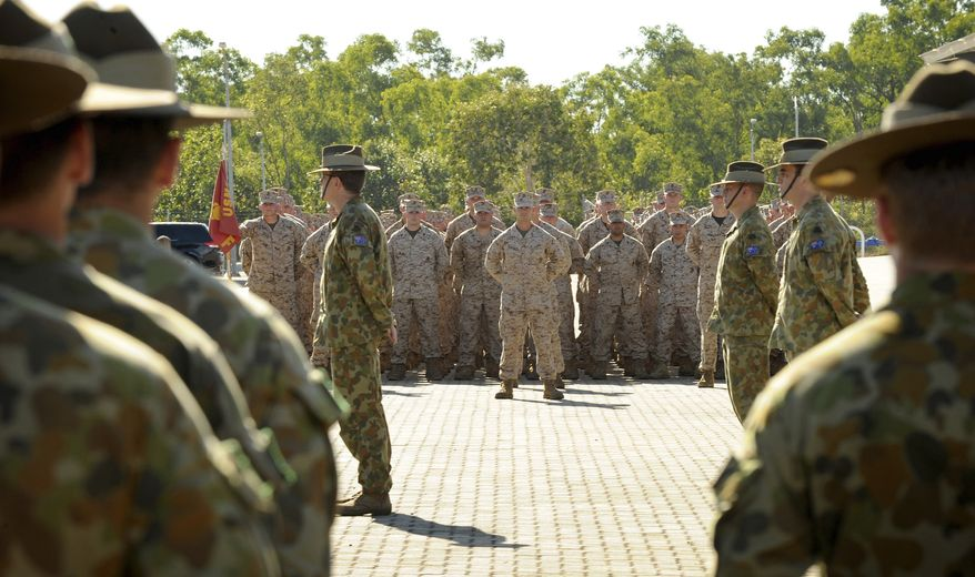 U.S. Marine Corps personnel stand at attention with the 5th Battalion Royal Australian Regiment on April 4, 2012, during an official welcome ceremony at Robertson Barracks in Darwin, Australia. The first detachment of 200 U.S. Marines has arrived in northern Australia, where a permanent joint training hub is taking shape as part of a U.S. shift of military strength in the Asia-Pacific region. (Associated Press/Australian Department of Defense)