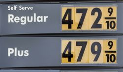 Gasoline prices are shown at a local gas station in Miami, Wednesday, April 4, 2012. (AP Photo/Alan Diaz)