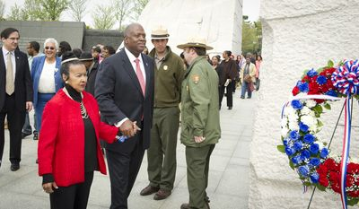 Dr. Xernona Clayton, President & CEO Trumpet Awards Foundation, Inc., (left)  and Harry E. Johnson, Sr., President, Washington D.C. Martin Luther KIng Jr. National Memorial Project Foundation, Inc. (right) take part in the wreath-laying ceremony during the Fair Housing Month 2012 Wreath-Laying Ceremony for the 44th anniversary of the 1968 assassination of Dr. Martin Luther King, Jr. (Rod Lamkey Jr/The Washington Times)
