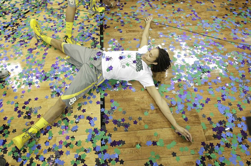 Baylor center Brittney Griner (42) celebrates in confetti during after the NCAA Women's Final Four college basketball championship game against Notre Dame, in Denver, Tuesday, April 3, 2012. Baylor won the championship 80-61. (AP Photo/Eric Gay)