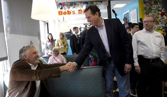 Republican presidential candidate Rick Santorum, a former Pennsylvania senator, shakes hands with a patron at Bob's Diner in Carnegie, Pa., on Wednesday, April 4, 2012. (AP Photo/Jae C. Hong)