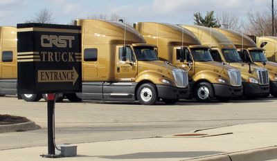 **FILE** Trucks sit outside the headquarters of CRST Van Expedited, Inc., in Cedar Rapids, Iowa, on March 12, 2012. (Associated Press)