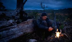 """Willem Dafoe plays a mercenary sent to Tasmania by a mysterious biotech company to hunt down a mythical creature in """"The Hunter."""" (Magnolia Pictures)"""