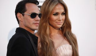 "Singers Marc Anthony and Jennifer Lopez will perform together on May 26 in Las Vegas as part of ""Q'Viva! The Chosen Live,"" which will feature the top talent from their TV talent show. (Associated Press)"