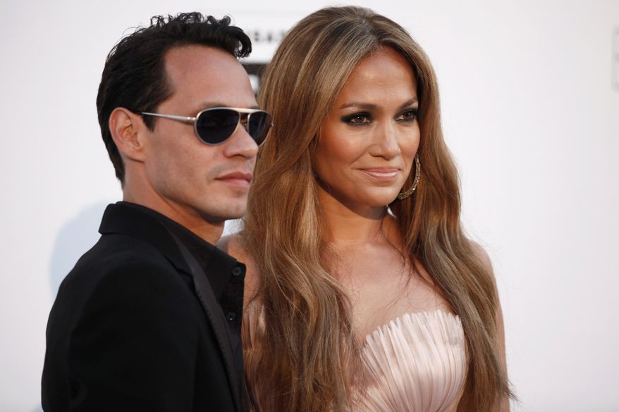 """Singers Marc Anthony and Jennifer Lopez will perform together on May 26 in Las Vegas as part of """"Q'Viva! The Chosen Live,"""" which will feature the top talent from their TV talent show. (Associated Press)"""