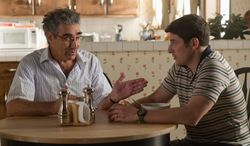 """Eugene Levy (left) is back as Jason Biggs' father in """"American Reunion,"""" but in the latest sequel in the """"American Pie"""" franchise they seem like a pair of ventriloquist dummies talking among themselves. (Universal Pictures via Associated Press)"""